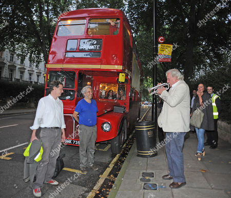 Author Alexander Masters (in White Shirt) And The Subject Of His Book Simon Norton (blue T-shirt) Board A Red Routemaster Bus Near Paddington Station Tonight At The Book Launch For The Book 'the Genius In My Basement'. Mr Norton Is Quite An Eccentric Who Loves These Type Of Buses And This Is Why The Bus Was Chosen To Ferry The Guests. Here A Friend Of Mr Norton Plays A Tune For Him.  07.09.11.