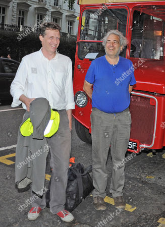 Editorial picture of Author Alexander Masters (in White Shirt) And The Subject Of His Book Simon Norton (blue T-shirt) Board A Red Routemaster Bus Near Paddington Station Tonight At The Book Launch For The Book 'the Genius In My Basement'. Mr Norton Is Quite An Eccentr