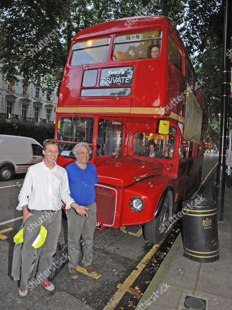 Editorial image of Author Alexander Masters (in White Shirt) And The Subject Of His Book Simon Norton (blue T-shirt) Board A Red Routemaster Bus Near Paddington Station Tonight At The Book Launch For The Book 'the Genius In My Basement'. Mr Norton Is Quite An Eccentr