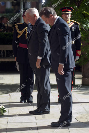 The U.s. Ambassador Louis Susman Left With Prime Minister David Cameron Pay Tribute To The Victims Of The U.s. Terror Attacks During A Ceremony At The 9/11 Memorial Garden In London To Mark The 10th Anniversary Of The Attacks.
