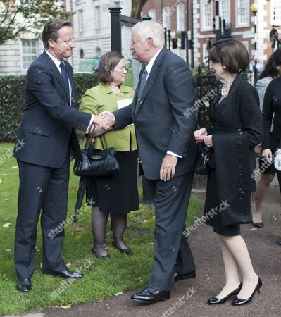 The Prime Minister David Cameron Meeting The U.s. Ambassador Louis Susman And His Wife Marjorie At A Memorial Ceremony At The Sept 11 Memorial Gardens In Grovesnor Square In London.