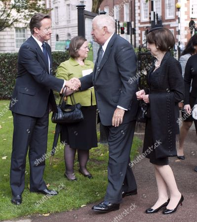 American Ambassador To Great Britain Louis Susman And His Wife Marjorie Meet Prime Minister David Cameron As They Arrive To Attend A Ceremony For Victims Of The Attacks On The World Trade Centre In New York Marking The Tenth Anniversary In Grosvenor Square In London.