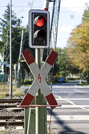 St Andrew`s Cross with red traffic light and opened gates, Hessen, Germany