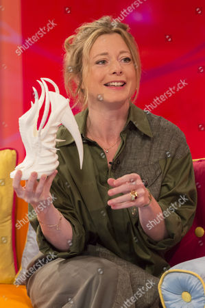 Tiffanie Darke holding a printed 3D shoe