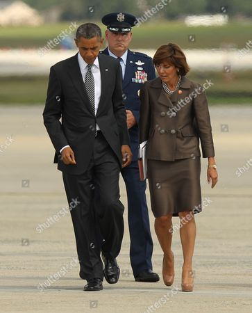 President Barack Obama is greeted by Colonel Michael Minihan, 89th Air Wing Commander and Capricia Marshall, Chief of Protocol