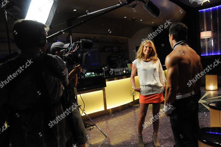 Sonia Kruger and Chippendale dancer
