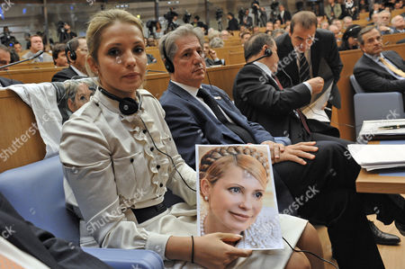 Yevhenia Tymoshenko holds a picture of her imprisoned mother