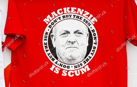 Stock Image of A t-shirt in protest of Kelvin MacKenzie and The Sun newspaper on sale outside the ground