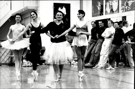 England Rugby Players Attended The Ballet Class With The English National Ballet. Brian Moore Leads The Girls With Theresa Jarvis (left) Sandra Ashwin (2nd Left) And Zara Deakin (right) On Their Points.