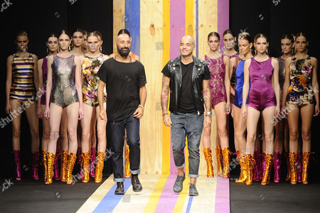 Stock Photo of Maurizio Modica and Pierfrancesco Gigliotti with their models on the catwalk