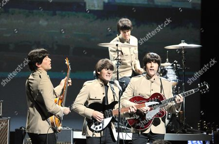 Ian B Garcia as Paul, Michael Gagliano as John, Phil Martin as Ringo and John Brosnan as George