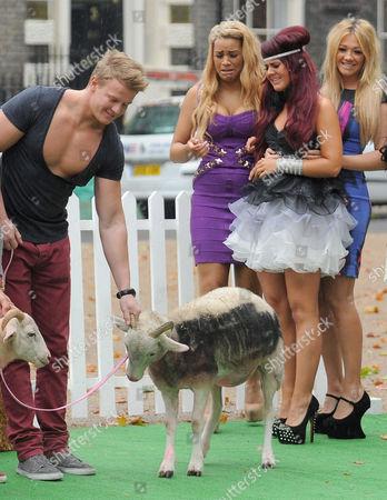 Stock Image of Lateysha Grace and Nicole Morris looking at sheep