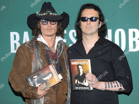 Johnny Depp and Damien Echols with his book 'Life After Death'