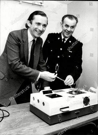 Norman Fowler Baron Fowler Of Sutton Coldfield Tries The New Breathalyser Machine With Chief Inspector Derek Hunt Of Sussex Police.