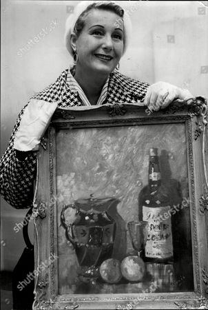 Stock Image of Actress Binnie Barnes With One Of The Still Life Paintings She Is Exhibiting.