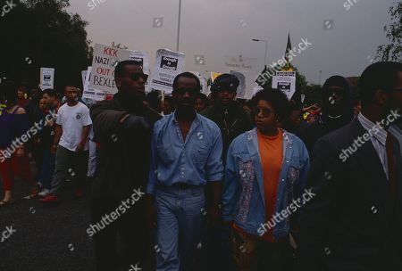 Anti-Nazi demonstrators march through South East London following the murder of black teenager Rolan Adams, including his parents Richard Adams and Audrey Adams