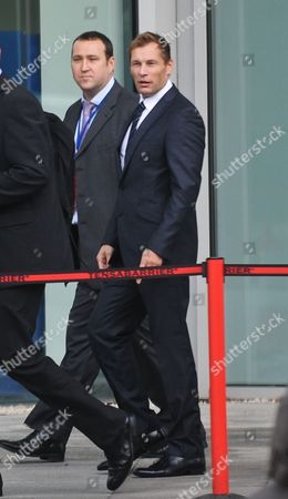 PC Simon Harwood (R), who was cleared of killing Ian Tomlinson during the G20 protests, arrives at Empress State Building for a disciplinary hearing