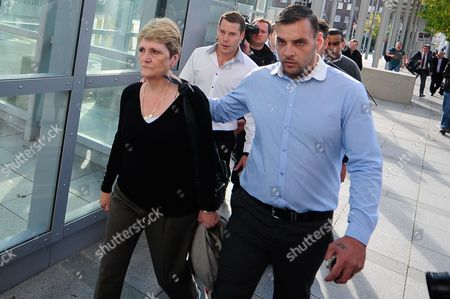 Stock Image of The family of Ian Thomlinson arrives at the Empress State Building