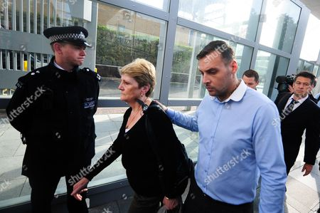 Stock Picture of The family of Ian Thomlinson arrives at the Empress State Building