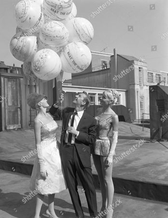 Norman Vaughan, Angela Bracewell and Beat the Clock Girls with free ticket balloons