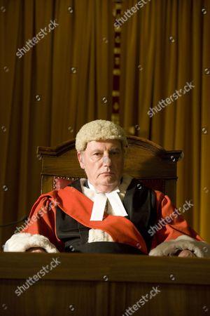 Stock Photo of Paul Darrow as Judge Prentice.