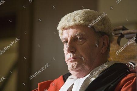 Stock Image of Paul Darrow as Judge Prentice.