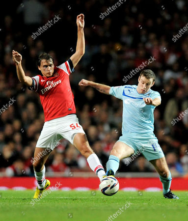 Ignasi Miquel of Arsenal and Stephen Elliott of Coventry