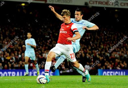 Andrei Arshavin of Arsenal scores his sides third goal