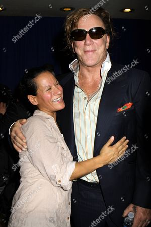 Mickey Rourke grabs hold of photograper Nancy Rivera