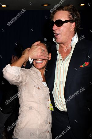 Stock Picture of Mickey Rourke grabs hold of photograper Nancy Rivera