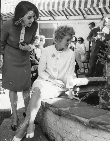 Actress Lynda Baron With Avril Angers Beside The Jacaranda's Pool.