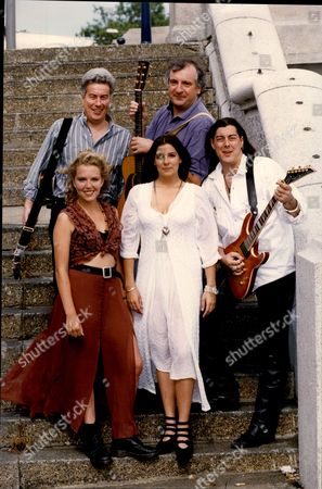 Authors Ken Follett (back Row Left) And Douglas Adams (back Row Right) With Front Row L-r: Lauren Marie-claire Follett And Follett (members Of The Band Nemesis).