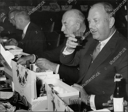 Sir Richard Beeching Takes A Drink During His Lunch At A Railway Meeting.