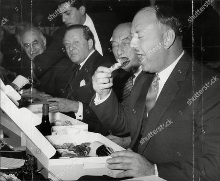 Sir Richard Beeching Eats A Chicken Leg During His Lunch At A Railway Meeting.