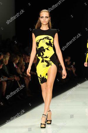 Cara Delevingne presents a creation by Italian designer Raffaele Borriello as part of his Spring/Summer 2013 women's ready-to-wear fashion show for French Fashion house Leonard