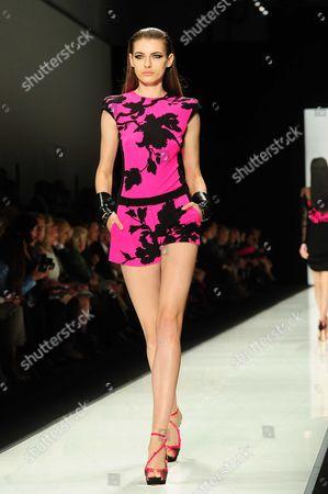 A model presents a creation by Italian designer Raffaele Borriello as part of his Spring/Summer 2013 women's ready-to-wear fashion show for French Fashion house Leonard
