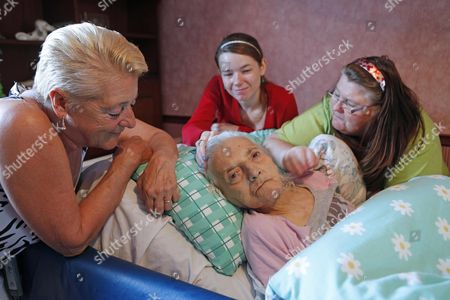 Editorial image of Emily Fisher Aged 86 Back Home In Grove Park After Being Cared For By Her Family In Hospital When She Was Refused Food And Drink By Medical Staff.(left To Right ) Pat Adshead (daughter) Danielle O'reilly (great Grandaughter ) And Vanessa Cowley (dau