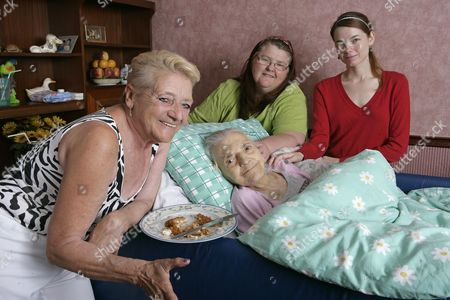Stock Photo of Emily Fisher Aged 86 Back Home In Grove Park After Being Cared For By Her Family In Hospital When She Was Refused Food And Drink By Medical Staff. (left To Right ) Pat Adshead (daughter) Vanessa Cowley ( Daughter-in-law) And Danielle O'reilly ( Great Grandaughter ).