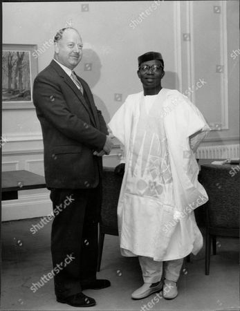 Richard Beeching (dead March 1985)chairman Of The British Railway Corporation Greets His Nigerian Counterpart Dr Okechukwu Ikejiani.