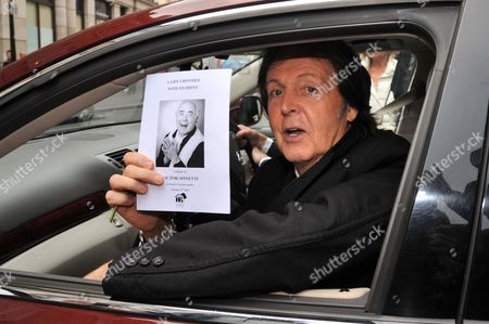 Sir Paul McCartney with order of service