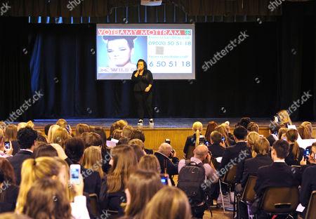 Amy Mottram performing in front of school children