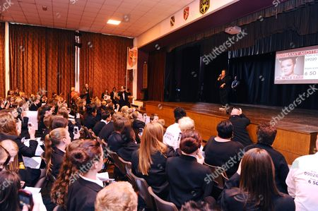 Amy Mottram in front of school children