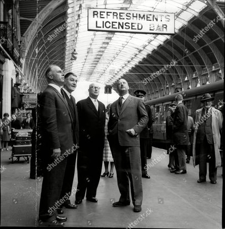 Dr Richard Beeching (lord Beeching) Chairman Of British Rail And Other British Rail Official At Paddington Railway Station To Look At The Newly Painted Roof.