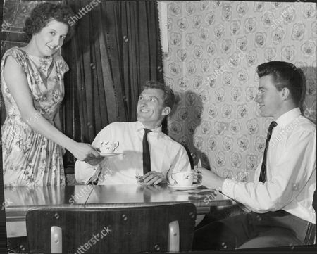 Tea Being Served By Mrs Margaret Byrne To Her Husband John Byrne Of (crystal Palace) And Their Friend And Rival Harold Redman (millwall).