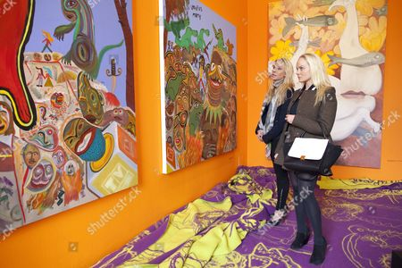Kathrine and Cecilie Fredriksen, daughters of John Fredriksen billionaire shipping tycoon enjoy the opening exhibition 'A House to Die in' by Bjarne Melgaard