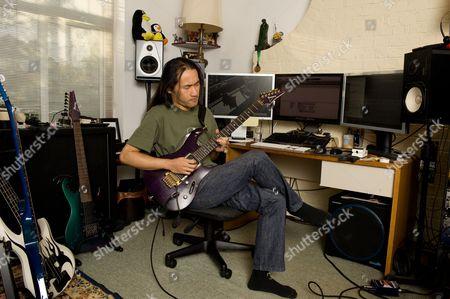 London United Kingdom - November 15: Herman Li Of British Power Metal Band Dragonforce During A Portrait Shoot At His Home Studio November 15