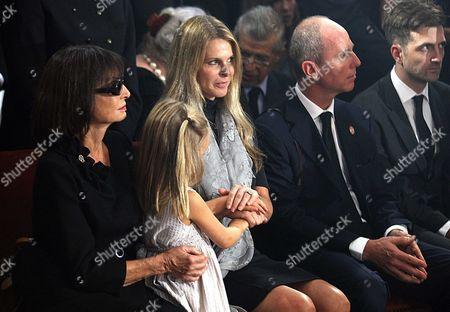 Catherine Oxenberg (centre), daughter of Princess Elizabeth Karadjordjevic (L), her husband (right), and daughter