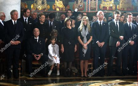 Serbia's Crown Prince Alexander stands with members of the royal family, including Princess Elizabeth and Catherine Oxenberg, inside the St George's Church on Oplenac Hill