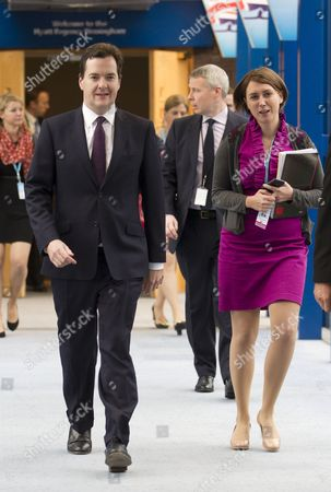 Stock Picture of Chancellor George Osborne with assistant Poppy Mitchell-Rose