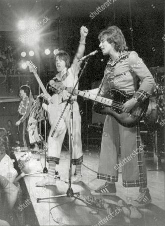 Pop Group Bay City Rollers In Concert In Wolverhampton The Bay City Rollers Were A Scottish Pop Band Whose Popularity Was Highest In The 1970s. The British Hit Singles & Albums Noted That They Were 'tartan Teen Sensations From Edinburgh' And Were 'the First Of Many Acts Heralded As The 'biggest Group Since The Beatles' And One Of The Most Screamed-at Teeny-bopper Acts Of The 1970s'.[1] For A Relatively Brief But Fervent Period (nicknamed 'rollermania') They Were Worldwide Teen Idols. The Group's Line-up Featured Numerous Changes Over The Years But The Classic Line-up During Its Heyday Included Guitarists Eric Faulkner And Stuart Wood Singer Les Mckeown Bassist Alan Longmuir And Drummer Derek Longmuir.